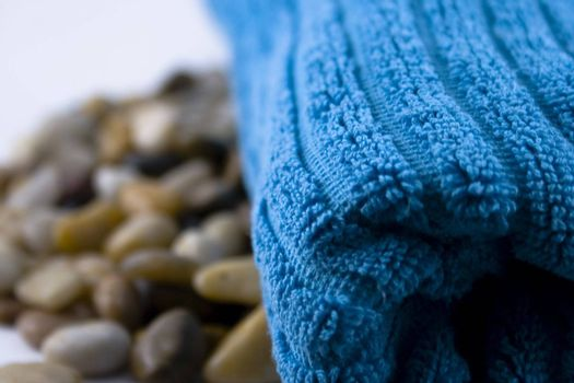Blue towel and a lot of little stones