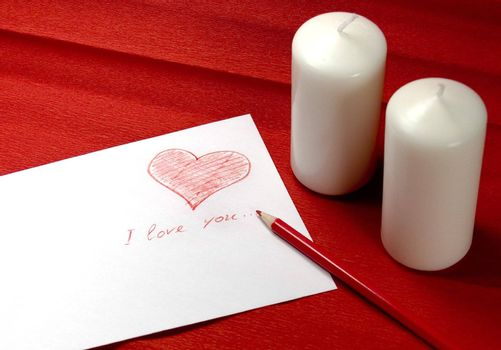 envelope with red heart and two candles on red background