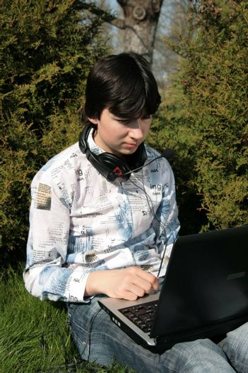 Closer view of a student and computer