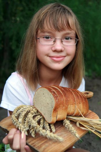 Girl with fresh bread