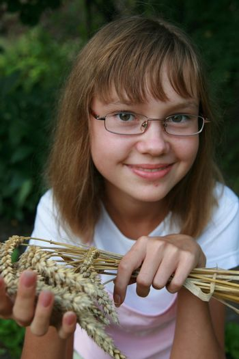 Girl with wheat on hand