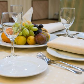 Table with fruits prepared for dinner in restaurant