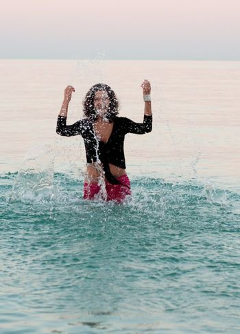 woman in wet clothes splashing