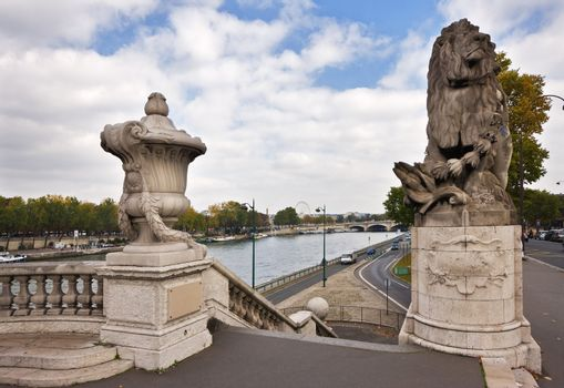 Alexandre III bridge in Paris - detail and view on Seine river
