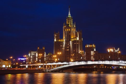 View across Moscow river in twilight - one of a few tall buildings built in 1940th and 1950th
