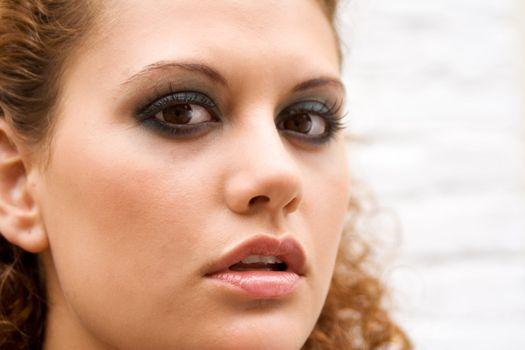 closeup portrait of a pretty brunette girl outdoors