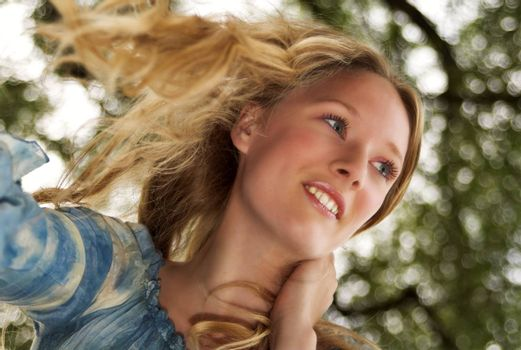 portrait of an attractive blonde taken from below