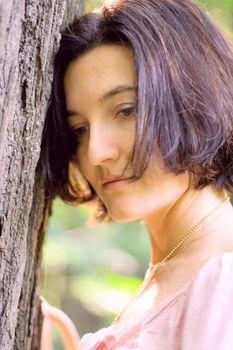 unhappy woman near the tree