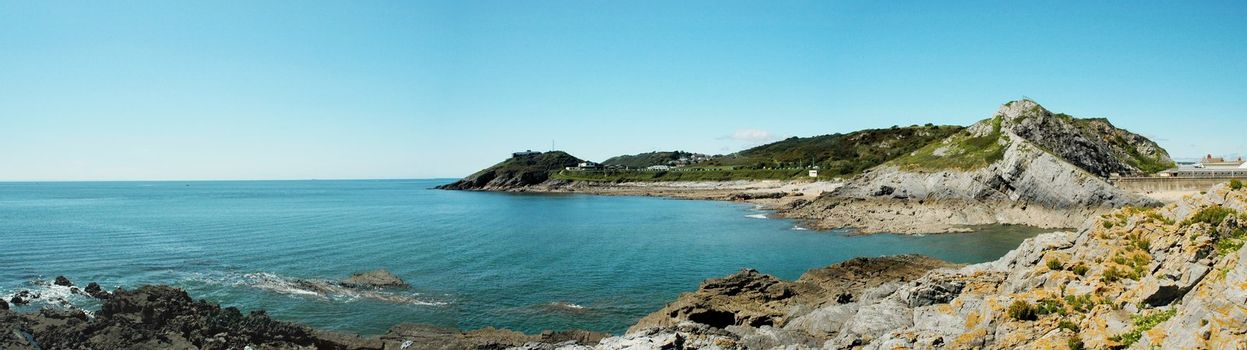 panorama of coast of Swansea in Wales with blue sky