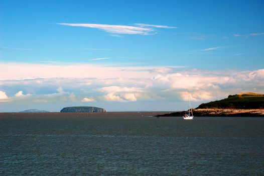sully island and sea,  horizontally framed picture with boat