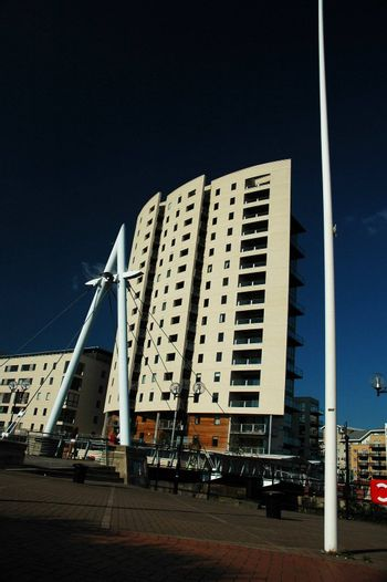 big high building in cardiff bay with blue sky