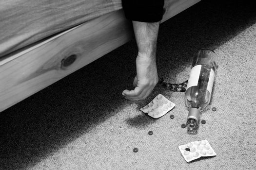 suicide in bed with pills and bottle of wine