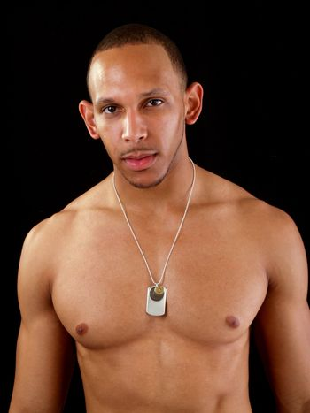 No shirt young black man with chain necklace strong