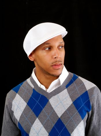 Young black man in white cap and sweater