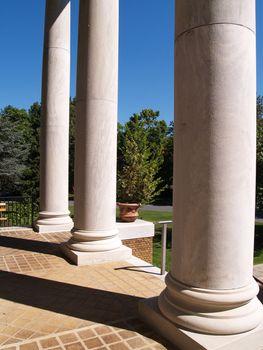 three large white classical columns