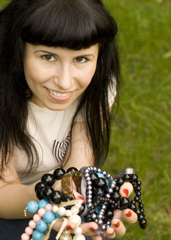 young brunette with beads