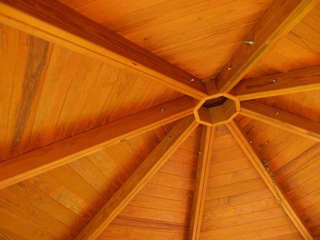 abstract view of the interior wood roof of an outdoor gazebo