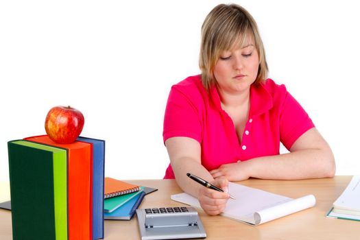Young female student is writing on white background