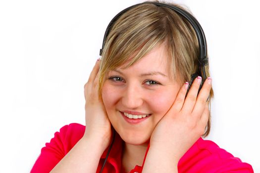 Young woman with headset on white background. Shot in studio.