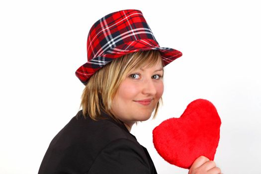 Young woman with velvet heart on white background