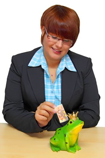 Beautiful businesswoman with piggy bank on bright background
