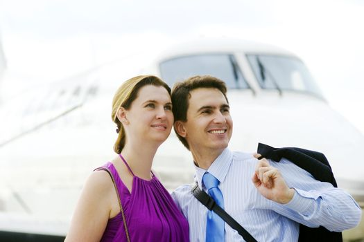 Businessman and his wife expect boarding on plane