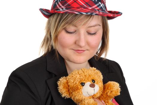 Young woman holding a teddy bear on white background