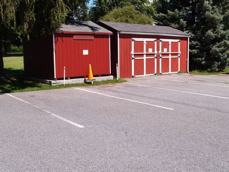 two wooden red sheds for storage