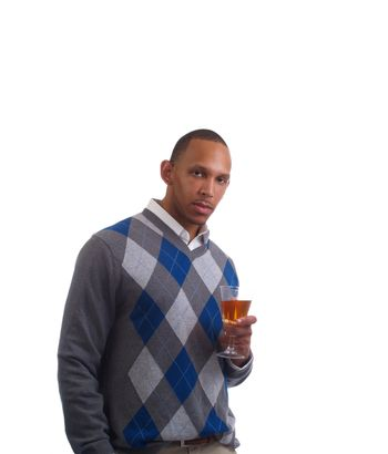 Young black man holding wine glass in sweater