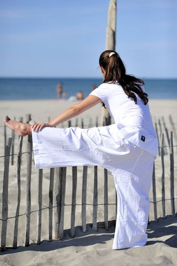 Woman doing stretching on the beach