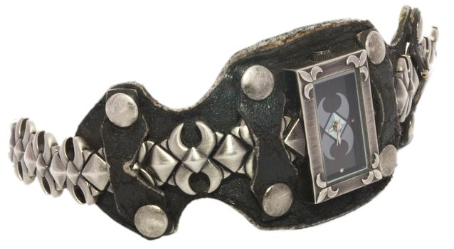 Vintage mechanical freak wristwatch with black leather bracelet