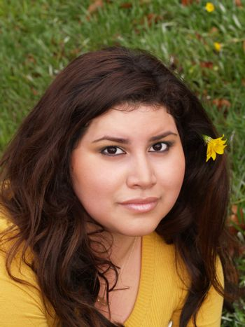 large hispanic woman portrait outdoors yellow sweater