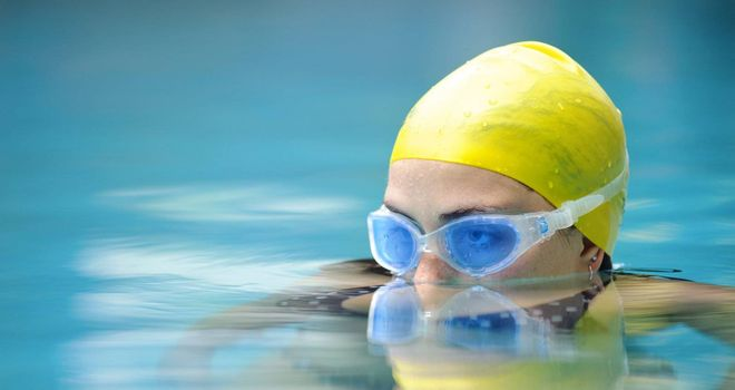 Submerged swimmer looks over the water surface