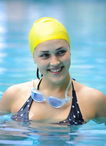Girl is happy in the pool while training