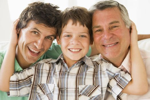 Grandfather with son and grandson smiling