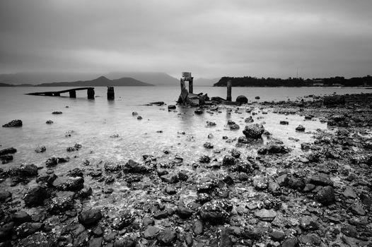 desolate and broken peer on the beach