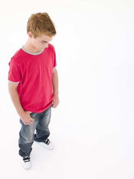 Teenage boy looking down