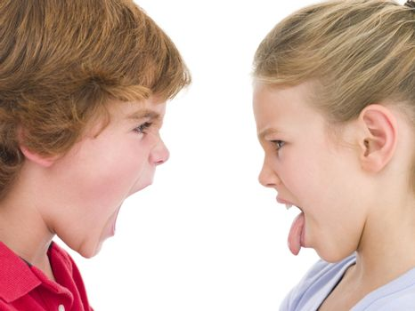 Brother shouting at sister sticking her tongue out
