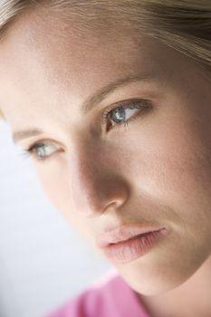 Head shot of woman thinking