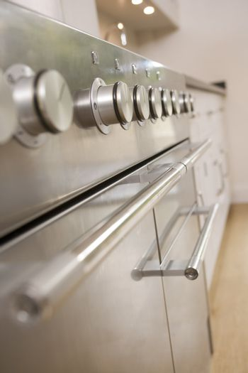 Empty kitchen with focus on stove dials