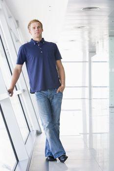 Man standing in corridor