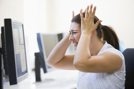 Woman in computer room looking frustrated