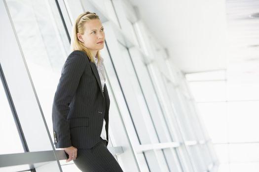 Businesswoman standing in corridor
