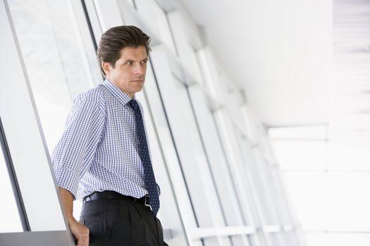 Businessman standing in corridor