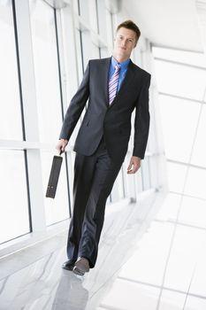 Businessman walking in corridor