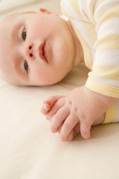 Baby lying indoors