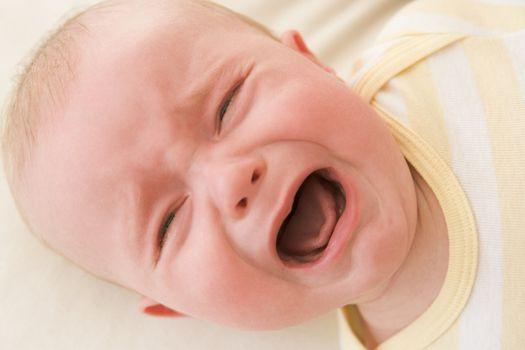 Baby lying indoors crying