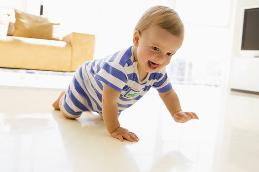 Baby crawling in living room