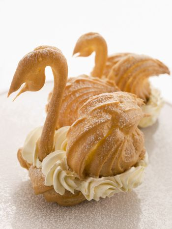 Two Choux Swans filled with Chantilly Cream