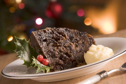 Portion of Christmas Pudding with Brandy Butter